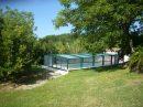 Maison de 4 ch sur sous-sol avec piscine chauffée et sauna